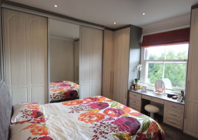 Great-Mixture-of-Sliding-and-Hinged-Traditional-Style-Wardrobes-in-White-Avola-with-a-matching-dresser-1030x443