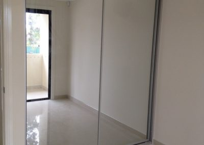 mirror+sliding+doors+with+matte+silver+frame