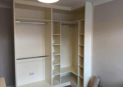 Fully-fitted-corner-wardrobe-exibiting-the-carcasses-1030x773