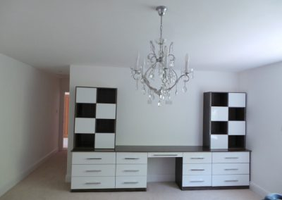 Great-example-of-Fully-Bespoke-White-Gloss-and-Dark-Walnut-unit-by-Capital-1030x773